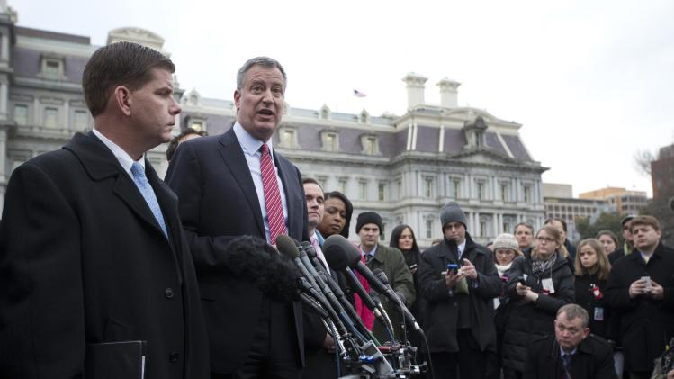 New York Mayor-elect Bill de Blasio and Boston Mayor-elect Martin Walsh speak to the press outside the West Wing of the White House in Washington