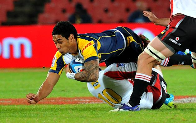Brumbies' flyhalf Joseph Tomane (Top) is tackled by Lions' flyhalf Elton Jantjies (10) during the Super 15 Rugby match between the Lions and Brumbies at the Ellis Park Stadium in Johannesburg, on Apri