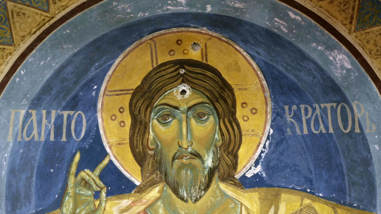 This photo shows a Serbian Orthodox style icon depicting Jesus Christ, damaged by bullet holes from rounds shot by Serbian communist supporters after World War II inside the Serbian royal family complex in Belgrade, Serbia, Tuesday, Jan. 22, 2013. The former king fled the Nazi occupation of Yugoslavia at the start of World War II and never returned, as Communists took over at the end of the war. He died in exile and was buried at a Serbian Orthodox monastery in Libertyville, Illinois — the only European monarch buried on U.S. soil. (AP Photo/Darko Vojinovic)
