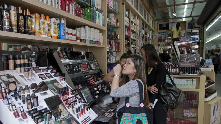 In this Feb. 4, 2013 photo, a customer tests make-up in a store in Sao Paulo, Brazil.  Sales of beauty products in Brazil hit $43 billion in 2011, a growth of 142 percent in five years that puts it on a pace to overtake the world's second-largest beauty market, Japan, in a few years, according to Euromonitor, a global market research company. (AP Photo/Andre Penner)