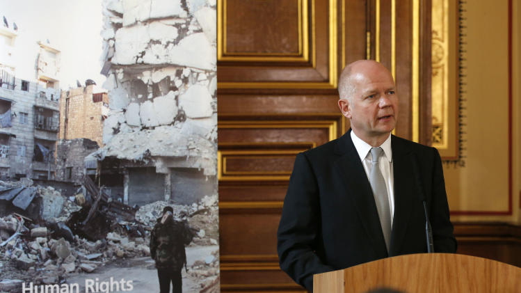 British Foreign Secretary William Hague speaks to the delegates and media during the launch of the Human Rights and Democracy Report at the Foreign and Commonwealth Office in London, Monday, April 15, 2013. (AP Photo/Sang Tan, Pool)