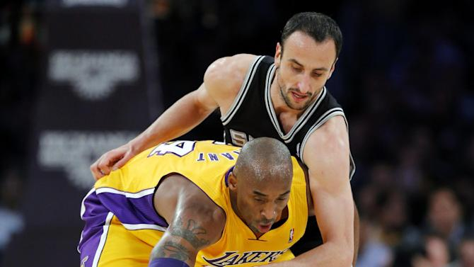 Los Angeles Lakers' Kobe Bryant is defended by San Antonio Spurs' Manu Ginobili, top, of Argentina, in the first half of an NBA basketball game in Los Angeles, Tuesday, Nov. 13, 2012. (AP Photo/Jae C. Hong)