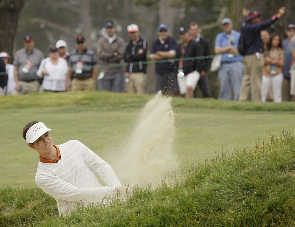 Amateur Beau Hossler hits out of a bunker on the second hole during the fourth round of the U.S. Open Championship golf tournament Sunday, June 17, 2012, at The Olympic Club in San Francisco. (AP Photo/Eric Risberg)