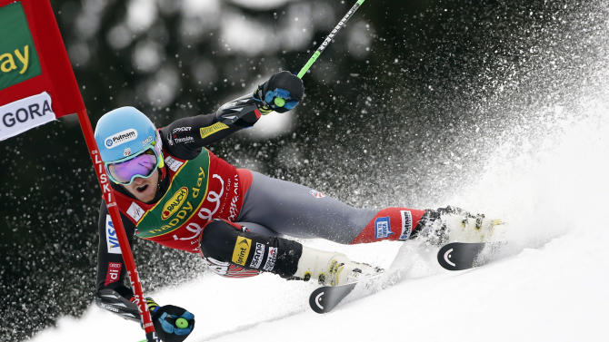 Ted Ligety, of the United States, passes a gate during the first run of an alpine ski, men's World Cup giant slalom, in Kranjska Gora, Slovenia, Saturday, March 9, 2013. (AP Photo/Alessandro Trovati)