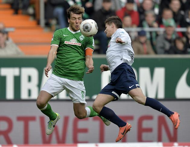 Bremen's Clemens Fritz, left, and Freiburg's Vaclav Pilar of Czech Republic challenge for the ball during the German first division Bundesliga soccer match between Werder Bremen and SC Freiburg in Bre