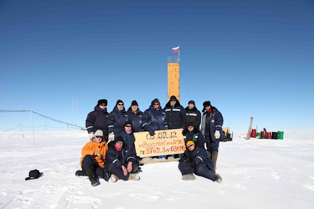 "In this Monday, Feb. 5, 2012 photo provided by the Arctic and Antarctic Research Institute of St. Petersburg, Russian researchers at the Vostok station in Antarctica pose for a picture after reaching the subglacial lake Vostok. Scientists hold the sign reading ""05.02.12, Vostok station, boreshaft 5gr, lake at depth 3769.3 metres."" The Russian team reached the lake hidden under miles of Antarctic ice on Sunday, a major scientific discovery that could provide clues for search for life on other planets. (AP Photo/Arctic and Antarctic Research Institute Press Service)"