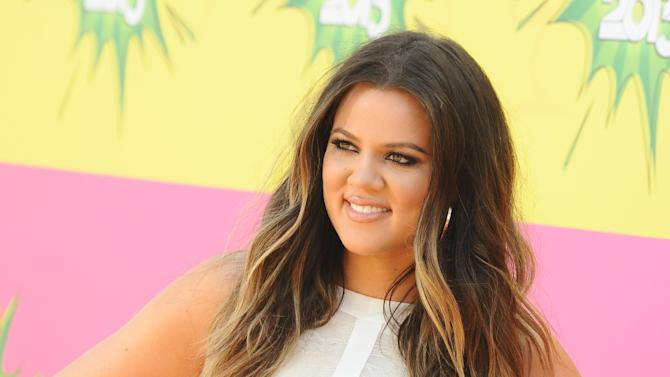 """FILE - In this March 23, 2013 file photo, Khloe Kardashian arrives at the 26th annual Nickelodeon's Kids' Choice Awards, in Los Angeles.  Kardashian is left out following the latest game of musical chairs on """"The X Factor."""" Fox said Monday, April 22, 2013,  that while Mario Lopez is returning this fall as host of Simon Cowell's music competition series, Kardashian will not be joining him. (Photo by Jordan Strauss/Invision/AP, File)"""