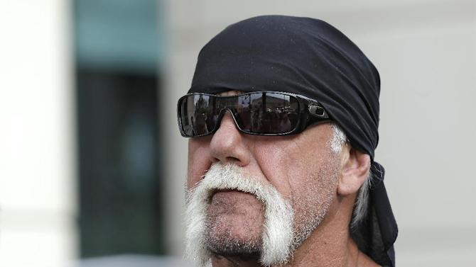 """Reality TV star and former pro wrestler Hulk Hogan, whose real name is Terry Bollea, looks on as his attorney speaks during a news conference Monday, Oct. 15, 2012 at the United States Courthouse in Tampa, Fla. Hogan says he was secretly taped six years ago having sex with the ex-wife of DJ Bubba """"The Love Sponge"""" Clem. Portions of the video of Hogan and Heather Clem were posted on the online gossip site Gawker. (AP Photo/Chris O'Meara)"""