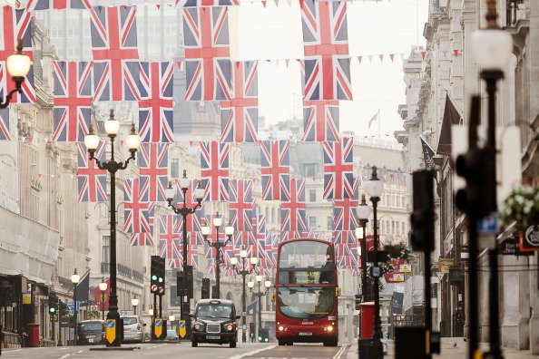 MAY 25: Union Jack pageantry hangs over Regents Street at sunrise on May 25, 2012 in London, England. With just over a week to go until the Queen's Diamond Jubilee, London is being decorated ready for