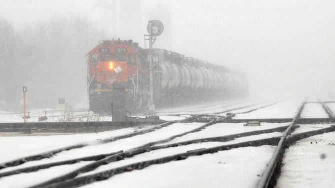 A BNSF train engine waits for another train to pass, Monday, Feb. 25, 2013, along Lorraine Street, just northeast of Avenue A in Hutchinson, Kan. Parts of Kansas are bracing for anywhere from 8 to 24 inches of snow as the system moves through the state overnight. (AP Photo/The Hutchinson News, Sandra Milburn)