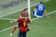 Spain forward Fernando Torres celebrates with teammate Juan Mata after scoring after 84 minutes of the Euro 2012 football championships final match against Italy at the Olympic Stadium in Kiev on July 1. Spain won 4-0