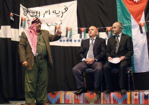 "Image provided by Amman's Concorde Theatre shows (L-R) Jordanian comedian Musa Hijazin in the role of Abu Saqer, actor George Hijazin playing the role of Jordan's prime minister and Hikmat Darwish impersonating a senior official in the play ""Now, I understand You"" in Septemer 2011. Every week, Jordanians pack the theatre to laugh at the shortcomings of their government"