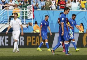 Uruguay's Suarez reacts after they won Italy in their 2014 World Cup Group D soccer match at the Dunas arena in Natal