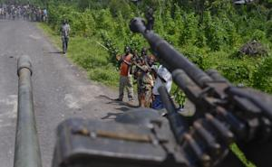 Residents cheer as Congolese army soldiers pass through …