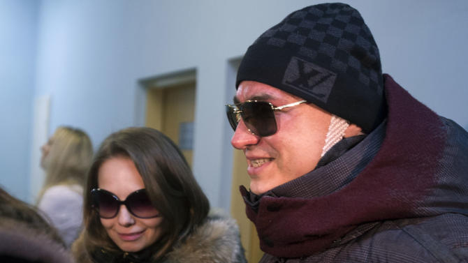 Artistic director of the Bolshoi ballet Sergei Filin, right, and his wife Maria, leave a hospital in Moscow, Russia, Monday, Feb. 4, 2013. Filin was attacked in Moscow on Thursday night, Jan. 17, 2013, by a man who splashed acid onto his face as the 43-year-old former dancer came out of his car outside his home in central Moscow. (AP Photo/Misha Japaridze)