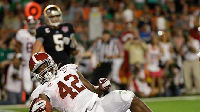 Alabama's Eddie Lacy falls into the end zone for a touchdown during the first half of the BCS National Championship college football game against Notre Dame Monday, Jan. 7, 2013, in Miami. (AP Photo/David J. Phillip)