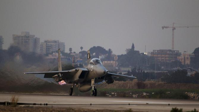 An Israeli air force F-15 Eagle jet fighter plane takes off from Tel Nof  air force base for a mission over Gaza Strip in central Israel, Monday, Nov. 19, 2012. (AP Photo/Ariel Schalit)