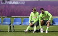 Portugal's Fabio Coentrao (L) and Cristiano Ronaldo prepare for a training session at the team's base camp in Opalenica. Poland were on Thursday preparing to kick off Euro 2012 on home soil, with opponents Greece seeking a morale-boosting win to lift a beleaguered nation hit by political turmoil and crippling financial woes