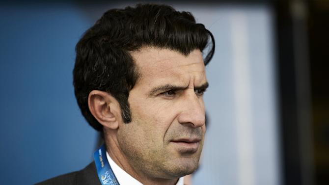 """One-time FIFA presidency candidate Luis Figo (pictured) hails Sepp Blatter's decision to step down as head of world football's governing body, saying """"change is finally coming"""" to the scandal-tainted organisation"""