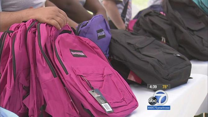 Back-to-school backpacks, supplies given out at Watts park