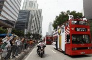 Miami Heat's Dwyane Wade waves from a doubledecker bus during a parade downtown in celebration of winning the NBA Finals basketball championship against the Oklahoma City Thunder, Monday, June 25, 2012, in Miami. (AP Photo/Lynne Sladky)