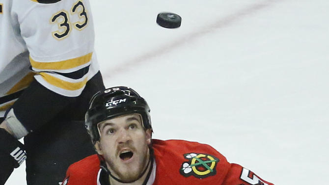Chicago Blackhawks center Andrew Shaw (65) keeps the puck in sight on a rebound during Game 2 of the NHL hockey Stanley Cup Finals against the Boston Bruins, Saturday, June 15, 2013, in Chicago. (AP Photo/Charles Rex Arbogast)
