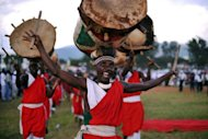 A traditional Burundian drummer performs at a political rally in Bujumbura. Burundi plans visiting royalty, marching bands and fireworks to mark 50 years of independence from Belgium, though in neighbouring Rwanda the ceremonies have a more sombre tone