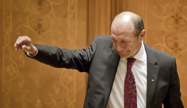 Romanian President Traian Basescu waves after his final speech in the country&#39;s parliament prior to a vote to impeach him in Bucharest, Romania, Friday, July 6, 2012. The governing coalition has vowed to go ahead with a vote to impeach President Traian Basescu, as the European Union expressed concern about Romania&#39;s rule of law. Parliament voted to suspend Basescu and a referrendum on his impeachment will take place on July 29, 2012. (AP Photo/Vadim Ghirda)