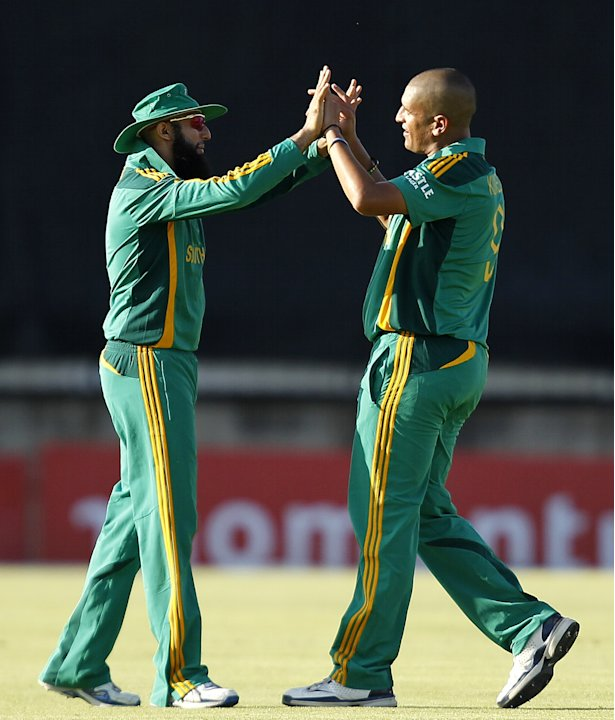 South Africa's Rory Kleinveldt celebrates winning against Pakistan with his teammate Hashim Amla at the end of their One day international cricket match in Bloemfontein
