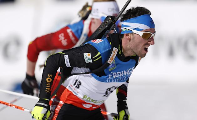 France's Jean Guillaume Beatrix competes in the men's 15km mass start at the biathlon World Cup competition in Pokljuka, Slovenia, Sunday, March 9, 2014