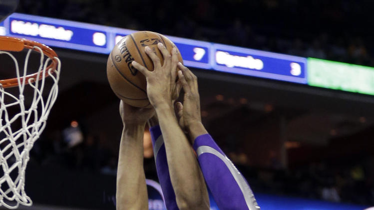 Charlotte Bobcats' Gerald Henderson, left, goes in to dunk as Los Angeles Lakers' Dwight Howard, right, defends during the first half of an NBA basketball game in Charlotte, N.C., Friday, Feb. 8, 2013. (AP Photo/Chuck Burton)