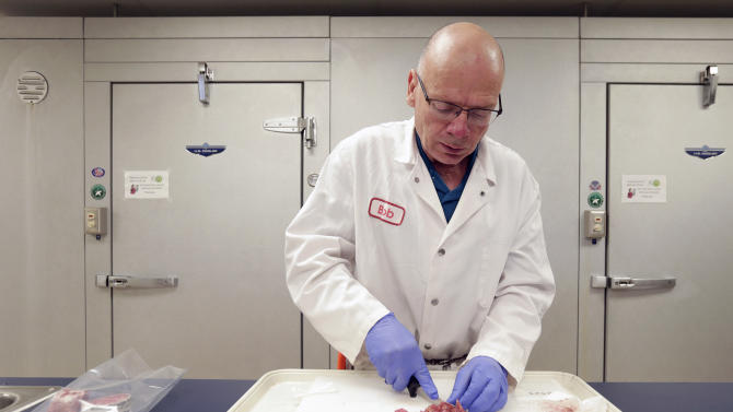In this Oct. 1, 2015, photo, meat scientist  Bob Danler prepares a sample of ground beef for testing at GreatO Premium Foods in Manhattan, Kan. The company is marketing beef with omega-3 fatty acids from cattle fed flaxseed with an eye to offering health-conscious consumers another wholesome dinner choice. (AP Photo/Charlie Riedel)