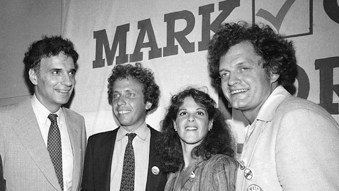 FILE - In this file photo of  Aug. 13, 1980 at a political fundraiser, from left, Ralph Nader, Mark Green, Gilda Radner and Harry Chapin, pose for a photo at the  in the Empire State Building New York. Before there was Band Aid or Live Aid, a We Are the World or Hands Across America, there was singer-songwriter Harry Chapin - lobbying for change in Congress, pestering an already convinced President Carter to establish a commission on world hunger, and passing the hat for donations at concerts large and small. (AP Photo/Nancy Kaye, File)