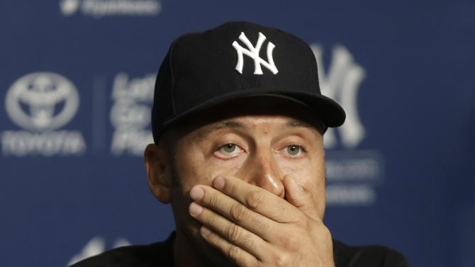 New York Yankees' Derek Jeter reacts while taking questions from reporters at a news conference after the Yankees' baseball game against the Kansas City Royals at Yankee Stadium on Thursday, July 11, 2013, in New York. The Yankees beat the Royals 8-4. Jeter left the game early with a tight right quadriceps. (AP Photo/Seth Wenig)