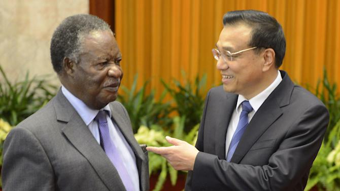 FILE - In this Saturday April 13, 2013 file photo Chinese Premier Li Keqiang, right, talks with Zambia's President Michael Sata before a meeting at the Great Hall of the People in Beijing, China. Zambia's relationship with China is growing quickly, spurring development but also friction. While there is gratitude for the scarce jobs and new infrastructure that China has bought, labor relations are sometimes tense and some Zambians claim they are being exploited. (AP Photo/Yohsuke Mizuno, Pool, File)