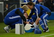 Schalke's midfielder Julian Draxler (C) receives treatment for an injury during a Champions League match on October 3. Draxler is set to return to training on Monday with the Royal Blues despite fracturing his arm less than 10 days ago in the 2-2 Champions League draw against Montpellier