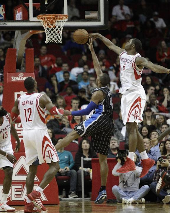 Orlando Magic power forward Andrew Nicholson (44) has his shot blocked by Houston Rockets power forward Terrence Jones (6) as power forward Dwight Howard (12) looks on during the second half of an NBA