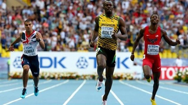 Usain Bolt of Jamaica crosses the line to win gold ahead of Adam Gemili of Great Britain and Curtis Mitchell of the United States in the Men's 200 metres final during Day Eight of the 14th IAAF World Athletics Championships Moscow 2013 at Luzhniki Stadium