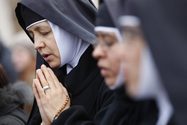Nuns pray prior to Pope Benedict XVI's last Angelus noon prayer, in St. Peter's Square, at the Vatican, Sunday, Feb. 24, 2013. The last chance for a Sunday blessing from Pope Benedict XVI from his stu