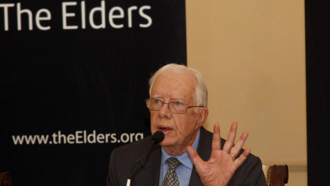 """Jimmy Carter, a former U.S. president, talks to journalists during a press conference at Strand Hotel in Yangon, Myanmar, Thursday, Sept. 26, 2013. Carter and other former world leaders, known as """"The Elders,"""" wrapped up a visit to Myanmar with calls to address spiraling Buddhist-led violence against minority Muslims. Myanmar's transition from a half-century of military dictatorship to a budding democracy won widespread praise from Carter and two other visiting """"Elders,"""" who pointed to the release of thousands of political prisoners, cease-fire agreements with many of the country's armed ethnic groups and an end to censorship. (AP Photo/Khin Maung Win)"""