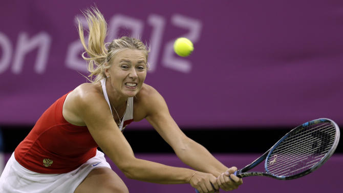 Maria Sharapova of Russia returns to Shahar Peer of Israel at the All England Lawn Tennis Club in Wimbledon, London at the 2012 Summer Olympics, Sunday, July 29, 2012. (AP Photo/Elise Amendola)