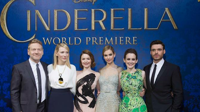 """Director Kenneth Branagh poses with cast members at the premiere of """"Cinderella"""" at El Capitan theatre in Hollywood"""