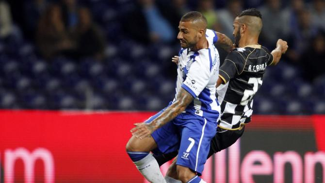 Porto's Quaresma fights for the ball with Boavista's Carvalho during their Portuguese Premier League soccer match at the Dragao stadium in Porto