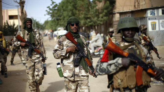 "Chadian soldiers patrol the streets of Gao, northern Mali, Tuesday Jan. 29, 2013, days after Malian and French military forces closed in and retook the town from Islamist rebels. Earlier Tuesday, four suspected extremists were arrested after being found by a youth militia calling themselves the ""Gao Patrolmen"". Malian soldiers prevented the mob from lynching them. (AP Photo/Jerome Delay)"