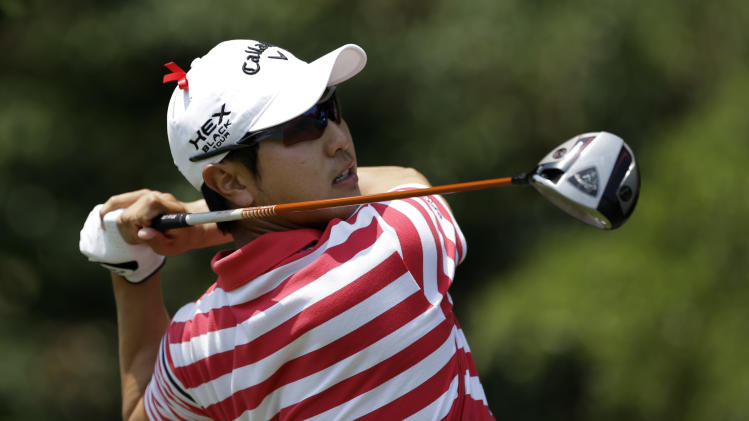 Sang-Moon Bae, of South Korea, hits off the first tee during the final round of the Byron Nelson golf tournament Sunday, May 19, 2013, in Irving, Texas. Bae and the rest of the field are wearing a red ribbon in memory of former US Open champion and long time analyst Ken Venturi. (AP Photo/Tony Gutierrez)