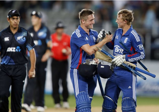 Root and Woakes of England celebrate winning against New Zealand during the final cricket match of their one day international series at Eden Park