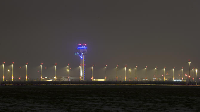 In this March 14, 2013 photo, the Berlin Brandenburg International Airport (BER) Willy-Brandt-Flughafen is seen partially illuminated in Schoenefeld near Berlin. The airport, also known as Willy Brandt International Airport, named for Germany's famed Cold War leader, was supposed to have been up and running in late 2011, a sign of Berlin's transformation from Cold War confrontation line to world class capital of Europe's economic powerhouse. Instead it has become a symbol of how, even for this technological titan, things can go horribly wrong. After four publicly announced delays, officials acknowledged the airport won't be ready by the latest target: October 2013. To spare themselves further embarrassment, officials have refused to set a new opening date.  (AP Photo/Markus Schreiber)