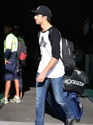 PERTH, AUSTRALIA - MARCH 17: Daniel Ricciardo of Australia and Infiniti Red Bull Racing walks to a waiting car after returning to Perth following the Australian Formula One Grand Prix at the Perth Domestic Airport on March 17, 2014 in Perth, Australia. (Photo by Paul Kane/Getty Images)