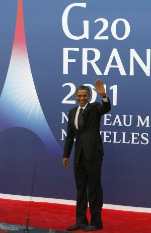U.S President Barack Obama arrives for Friday's first working session at the G20 summit in Cannes, Friday, Nov. 4, 2011. European leaders had meant to use the summit of the Group of 20 leading economies in Cannes, France to get foreign powers like China to help with the debt crisis that has rocked the eurozone for the past two years and threatens to push the world economy into a second recession. (AP Photo/Remy de la Mauviniere)