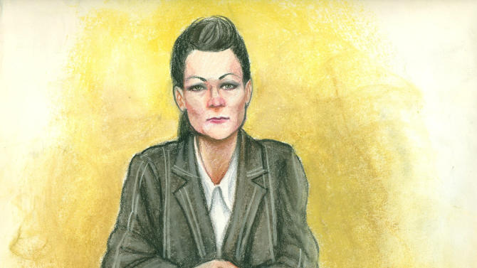 """FILE - In a file photo of a  courtroom sketch, a government informant, identified in court records as Rebecca Williams, testifies Wednesday, Jan. 25, 2012, in Phoenix in the trial of two white supremacist brothers charged with bombing a black city official in Scottsdale, Ariz. Williams, dubbed a """"trailer park Mata Hari"""" by defense attorneys, spent about five years talking with identical twins Dennis and Daniel Mahon, surreptitiously recording their conversations and getting them to open up about the plot with a series of provocative acts. A federal judge is scheduled Tuesday to sentence 61-year-old Dennis Mahon for his conviction in the 2004 bombing. (AP Photo/Maggie Keane/file)"""